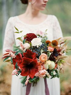 26 Wedding Bouquets for Winter Brides & Their Maids ~ Amaryllis = holiday to us!  love the deep red amaryllis and dahlia, berries and pine...Plum Sage Flowers