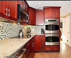 Norcraft Cabinetry in Maple Shaker Style Kitchen Cabinet,Glass Mosaic Backsplash, Stainless Steel Appliances, Quartz Stone countertop and Tiled Kitchen floor.   #RhodeIslandKitchen www.cypressdesignco.com