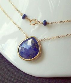 *SALE!!! Use coupon code END2010BDF at checkout to receive 10% discount on your purchase. Sale does not apply to previously purchased items. Enjoy!!!    A gorgeous, large Lapis Lazuli faceted briolette bezel set in 22K Vermeil (22K Gold over sterling silver) pendant, suspended on 14K Goldfilled chain, and finished off with Lapis smooth rondelles at the springring clasp. The Lapis stone has a wonderful, deep blue cobalt color with flecks of golden Pyrite on both sides, that make a rich…