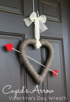 Cupid's Arrow Valentine's Day Wreath - with the help of yarn or craft strings, you can make this wonderful Cupid's Arrow and Heart wreath.