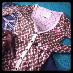 Volcom Sweater 🎀 Volcom sweater with bow detail on cuff. Animal style print with Volcom stones. Super cute over a tank Volcom Sweaters