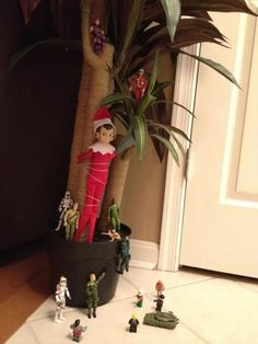 Elf on the Shelf Captured  My son's action figures are protecting their turf.  The elf gets revenge after escaping from the action figures.