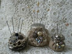 Pincushions made from Salt Shaker Tops and Lace.