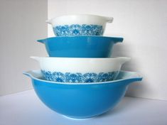 1970's Pyrex cinderella bowls in Horizon Blue. These bowls are a complete set in solid blue paired with a unique combination of blue mod art