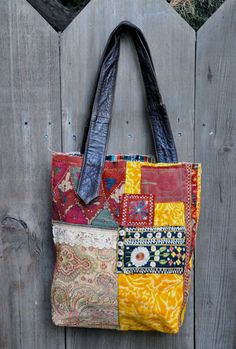 Krishna and Radha* are surrounded in vibrant golds and oranges on this casual tote. Vintage draperies make up the main body of the bag with
