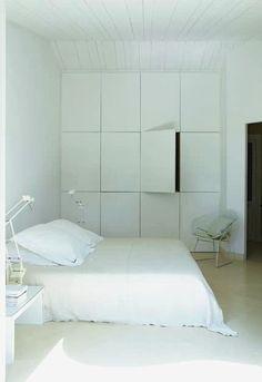 White wall closet discreet modern storage