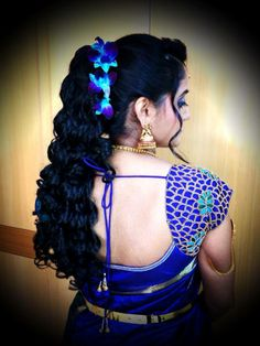 Indian bride's bridal reception hairstyle styled by Swank Studio