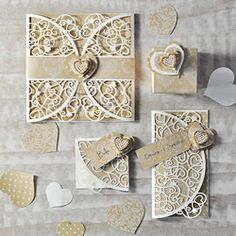 DIY laser cut wedding stationery. Make your own heart theme wedding invitations and wedding stationery with a rustic feel