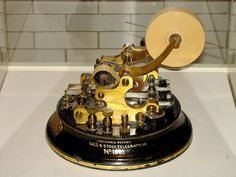 A gold stock ticker, designed by American Gilded Age inventor, Thomas Alva Edison.