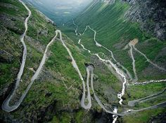 TROLLSTIGEN (English: Troll's Path), Rauma, Norway, part of Norwegian National Road 63 connecting Åndalsnes in Rauma and Valldal in Norddal. Trollstigen was opened on July 31, 1936, by King Haakon VII after 8 years of construction.