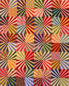 Hot off the sewing machine: the Ferris Wheel quilt! There's a pattern  for it too. This is a fun way to make fan blocks. No paper-pieci...