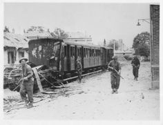 Canadians clear snipers at Falaise railway station!