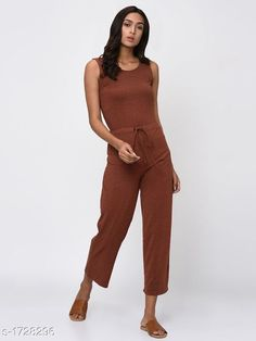 Jumpsuits Elegant Women's Jumpsuit  *Fabric* Cotton  *Sleeves* Sleeves Are Not Included  *Size* S - 36 in , M - 38 in , L - 40 in  *Length* Up To 46 in  *Type* Stitched  *Description* It Has 1 Piece Of Women's Jumpsuit  *Pattern* Solid  *Sizes Available* XXS, XS, S, M, L, XL, XXL, XXXL, 4XL, 5XL, 6XL, 7XL, 8XL, 9XL, 10XL, Free Size *   Catalog Rating: ★4.2 (230)  Catalog Name: Adeline Elegant Womens Jumpsuits CatalogID_226201 C79-SC1030 Code: 073-1728296-