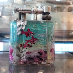 Alfred Dunhill 'Aquarium' Lighter   From a unique collection of antique and modern tobacco accessories at https://www.1stdibs.com/furniture/more-furniture-collectibles/tobacco-accessories/