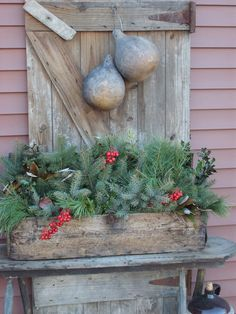 Old Weathered Barn Door...and old wooden box filled with pine.