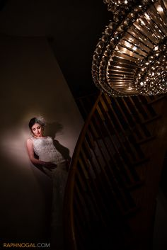 bride on stairs, wedding day, bride getting ready, chandelier, off camera flash, magma grid and gel