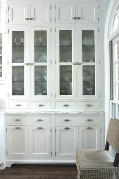 Built-In Hutch with Glass Doors beyond adore this built in for pottery in kitchen http://www.bhg.com/kitchen/storage/organization/kitchen-hutch-ideas/