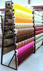 My space will have extensive storage facilities- I want the products to become part of the design. Google Image Result for http://warehousefabricsinc.com/Merchant2/graphics/00000001/fabricdisplayrackth.jpg