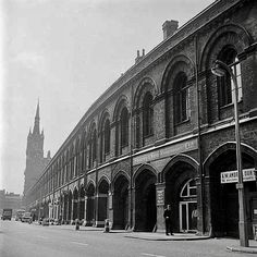 Looking south from Pancras Road along the side of St Pancras Station buildings with the tower of the south front visible in the distance. Camden London, Old London, London History, Vintage London, Old Town, Distance, Transportation, Cities, Random Stuff