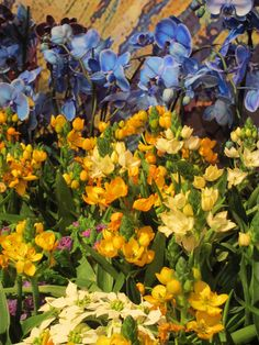 Blue orchids set off these yellow flowers at the Macy's Flower Show 2015 Minneapolis