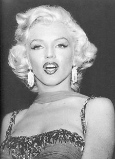 Marilyn at a benefit for St. Jude's Children's Hospital at the Hollywood Bowl, 1953. Photo by Bruno Bernard.