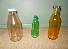 Tinted glass bottles made with Mod Podge.