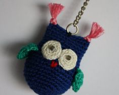 Hand crocheted owl keyring made from cotton and wool yarns, stuffed with polyester. Measures approx. 5 cm plus keyring clip. Hand wash recommended.