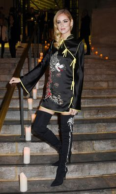 Chiara Ferragni wore a satin minidress with thigh high boots to the Vogue party in Paris.