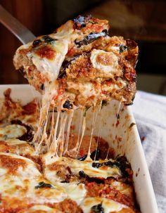 Eggplant Parmesan. Classic Italian comfort food, layers of fried, crispy eggplant, marinara, mozzarella and Parmesan.