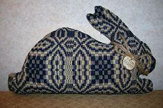 Primitive Rabbit, door stopper, or change to a deer.  Could blackwork stitch it.