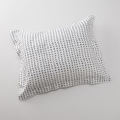 Designed by Portland-based artist Ashley Goldberg, the playful imperfection in the hand-drawn navy pluses are inviting despite the clean, uniform rows. Crafted from crisp 200-thread count percale cotton, the tightly woven fibers provide long-lasting durability with a soft, luxurious feel. Special details include a hand-stitched label and shell-button closures on the pillowcases. Mix and match with any of our duvet covers or sheets for unexpected yet effortless pairings. A Schoolhouse…