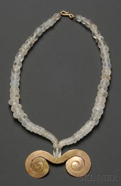 Pre-Columbian Rock Crystal Necklace with Gold Pendant, Colombia, Tairona, c. 1000-1500 A.D., various size beads and hammered spiral adornment.~
