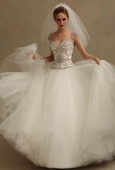 Brides: Eve of Milady. Tulle ballgown, with beaded bodice and cap sleeves.