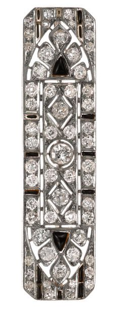 An art deco diamond and black onyx brooch, circa 1930  set throughout with old European and old single-cut diamonds; estimated total diamond weight: 3.55 carats; mounted in platinum; length: 2 5/8in.
