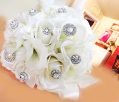 http://www.facebook.com/smugladybug Real touch ivory bridal bouquet with blinged out flower tips