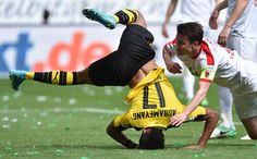TOPSHOT - Dortmund's Gabonese striker Pierre-Emerick Aubameyang (L) falls beside of Augsburg's Dutch defender Paul Verhaegh (R) during the German first division Bundesliga football match between FC Augsburg and Borussia Dortmund on May 13, 2017 in Augsburg, southern Germany.  / AFP PHOTO / Christof STACHE / RESTRICTIONS: DURING MATCH TIME: DFL RULES TO LIMIT THE ONLINE USAGE TO 15 PICTURES PER MATCH AND FORBID IMAGE SEQUENCES TO SIMULATE VIDEO. == RESTRICTED TO EDITORIAL USE == FOR FURTHER…