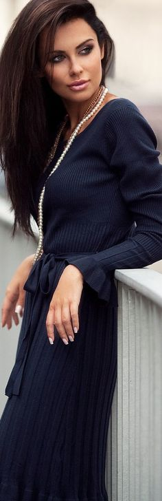 Navy, pleats and pearls.