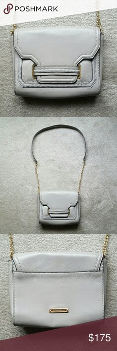 NEW! Vince Camuto Jess Crossbody Bag BRAND NEW - NEVER BEEN USED - PERFECT CONDITION! Ash gray Vince Camuto cross body bag with gold detailing. Magnet keeps bag closed when front flap is closed - one zipper pocket inside + one large cellphone phone inside! Vince Camuto logo on back. Dimensions: 8.5 in (H) x 9.5 in (L) x 2 in (W). ****Please Note: I'm an impulse shopper so I took the tags off as soon as I purchased this and brought it home & ended up never using it! Has never seen the light…