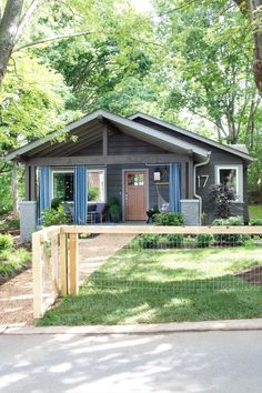 I like the outdoor curtains and that fence could be perfect for our front yard. Cute cottage/contemporary exterior. Front Yard Pictures From HGTV Urban Oasis 2015 | HGTV Urban Oasis Sweepstakes | HGTV