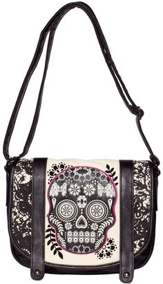 LOUNGEFLY LACE SKULL WITH FUSCHIA MESSENGER BAG Loungefly presents the handy Lace Skull messenger bag! This faux leather messenger style bag features a natural canvas front flap with printed lace details, sugar skull applique & flocked floral details. Inside is lined with a black & pink polka dot fabric, held together by magnetic snap, there's also an inside zip & open pocket to keep you bag organized. $56.00