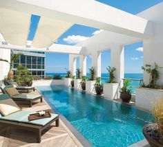 Architecture Meets Design In An Asian and Art Deco-Inspired Penthouse Offering 360-Degree Panoramas Of Miami