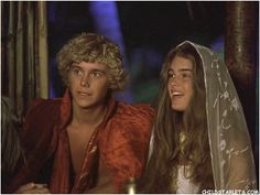 """Brooke Shields and Christopher Atkins singing Christmas carols in """"The Blue Lagoon,"""" 1980."""