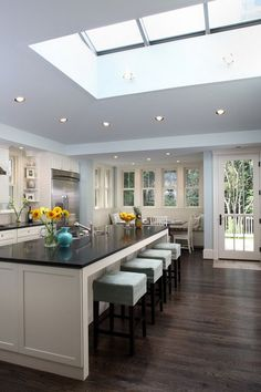 love how bright and open this kitchen is - look at that light pouring in from the skylight!