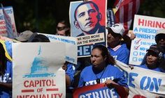 Protesters demand a rise in the federal minimum wage to $15 per hour, on Capitol Hill in Washington DC.