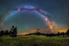 Dave Lane Astrophotography  -  America's first national monument, Devils Tower is a geologic feature that protrudes out of the rolling prairie in Wyoming. David Lane captured this amazing 16-image panorama of the monument illuminated by the Milky Way and green airglow.