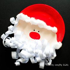 Kids will love cutting, sticking, painting and curling to create an adorable Paper Plate Santa Claus with a lushious curly paper beard!