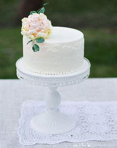 This would be cute as a centerpiece on each table. I went to a wedding where they did that and everyone just served their own cake at each table. It was cute!!!