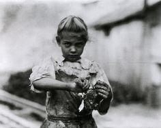 Lewis W. Hine -  Seven-year-old Rosie, an experienced oyster shucker, Bluffton, South Carolina, 1913 - from Kids at Work - Lewis Hine and the Crusade Against Child Labor by Russell Freedman