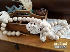 Add a rustic farmhouse flair to your home decor with this handmade wooden bead garland. Use it in your home decor and more.