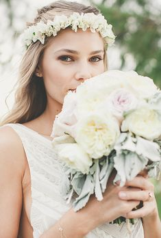 Brides.com: . This bride puts a boho twist on the traditional Hawaiian leis. Perfect for warm-weather ceremonies, an ivory leis provides a casual touch against long wind-blown waves.